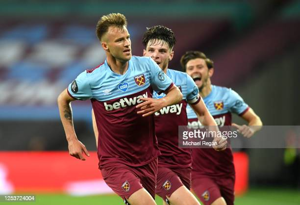 Andriy Yarmolenko of West Ham celebrates with teammates after scoring his team's third goal during the Premier League match between West Ham United...