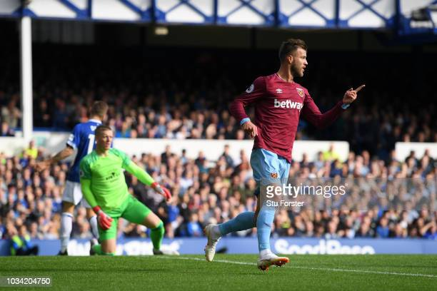 Andriy Yarmolenko of West Ham United celebrates after scoring his team's first goal during the Premier League match between Everton FC and West Ham...