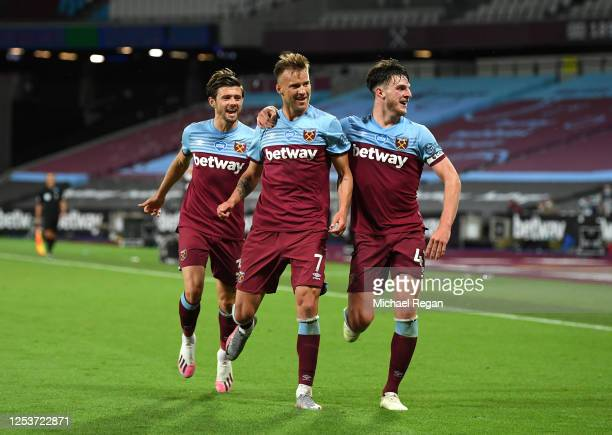 Andriy Yarmolenko of West Ham United celebrates after scoring his team's third goal with team mates during the Premier League match between West Ham...