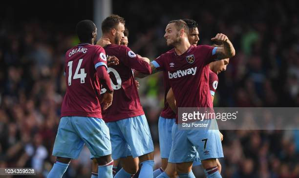 Andriy Yarmolenko of West Ham United celebrates with Marko Arnautovic after scoring the second West Ham goal during the Premier League match between...