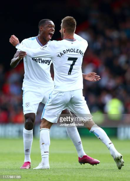 Andriy Yarmolenko of West Ham United celebrates with teammate Issa Diop after scoring his team's first goal during the Premier League match between...