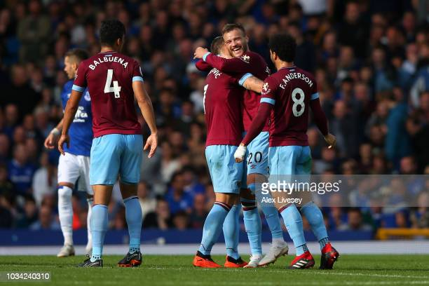 Andriy Yarmolenko of West Ham United celebrates with teammates after scoring his team's second goal during the Premier League match between Everton...