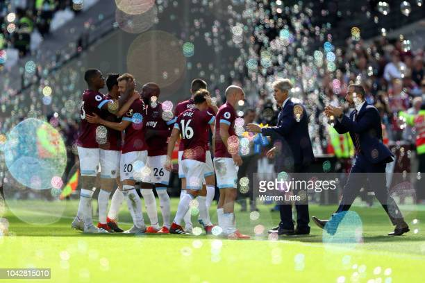 Andriy Yarmolenko of West Ham United celebrates with teammates after scoring the second West Ham United goal during the Premier League match between...