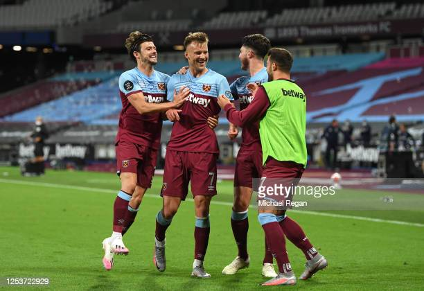 Andriy Yarmolenko of West Ham United celebrates with teammates after scoring his team's third goal during the Premier League match between West Ham...