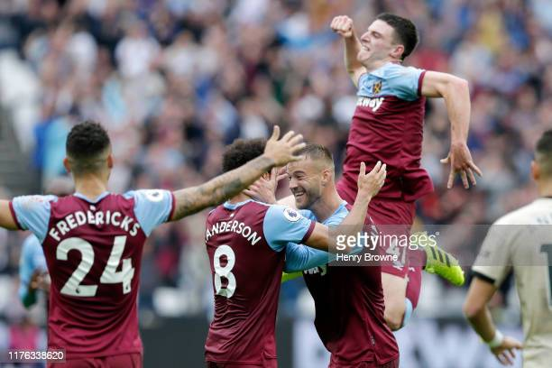 Andriy Yarmolenko of West Ham United celebrates with teammates Felipe Anderson and Declan Rice after scoring his team's first goal during the Premier...