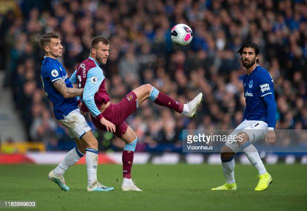 Andriy Yarmolenko of West Ham United in action with Lucas Digne and Andre Gomes of Everton during the Premier League match between Everton FC and...