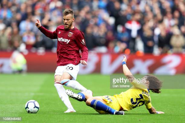 Andriy Yarmolenko of West Ham United leaps over David Luiz of Chelsea during the Premier League match between West Ham United and Chelsea FC at...