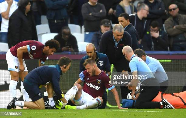 Andriy Yarmolenko of West Ham United recieves medial treatment during the Premier League match between West Ham United and Tottenham Hotspur at...