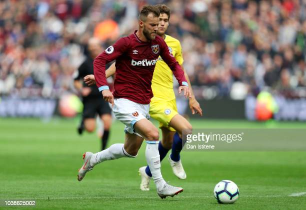 Andriy Yarmolenko of West Ham United runs with the ball past Marcos Alonso of Chelsea during the Premier League match between West Ham United and...