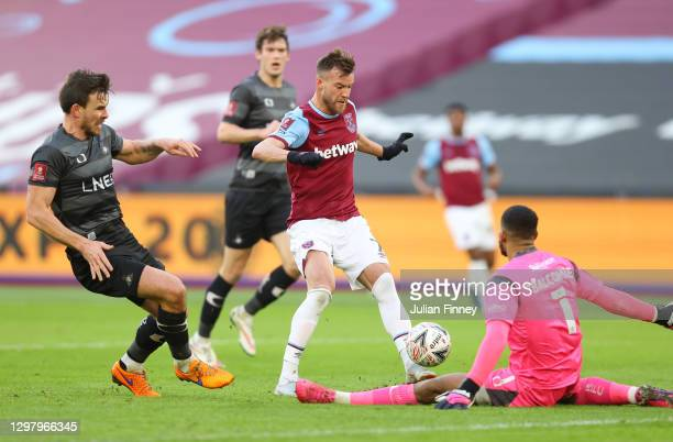 Andriy Yarmolenko of West Ham United scores their side's second goal past Ellery Balcombe of Doncaster Rovers during The Emirates FA Cup Fourth Round...