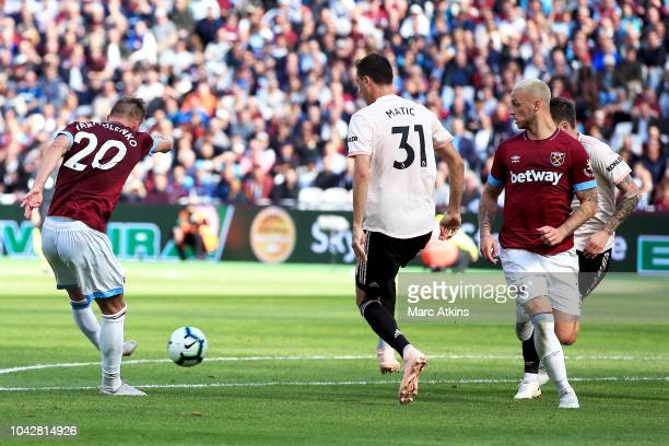 Andriy Yarmolenko of West Ham United shot at goal is deflected of Nemanja Matic of Manchester United for the second West Ham United goal during the...