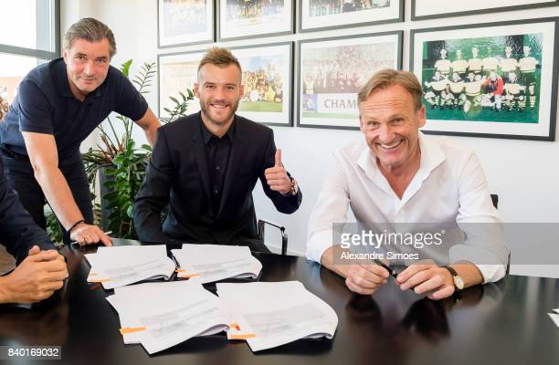 Andriy Yarmolenko signs a new contract with Borussia Dortmund with Michael Zorc and HansJoachim Watzke on August 28 2017 in Dortmund Germany