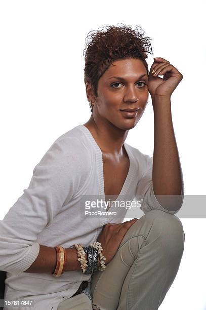 androgynous man sitting - transgender man stock photos and pictures