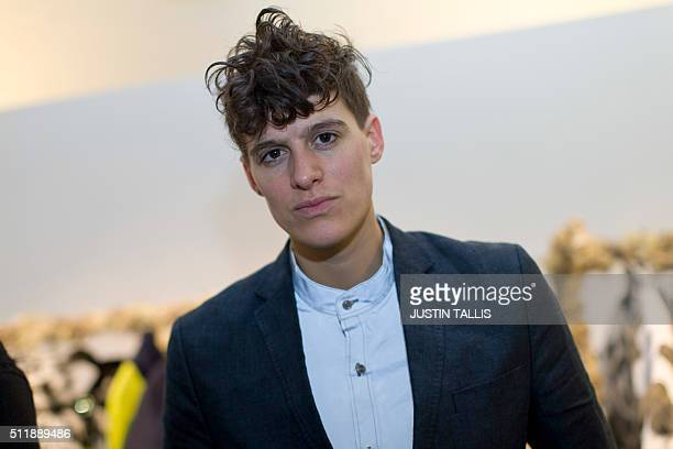 Androgynous model Rain Dove poses for a portrait in the London Fashion Week venue in Soho in central London on February 23 2016 Transgender models...