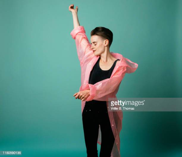 androgynous young woman dancing - entertainment occupation stock pictures, royalty-free photos & images