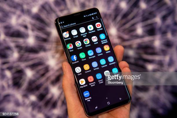 Android app icons sit on the homescreen of the Galaxy S9 smartphone during a Samsung Electronics Co 'Unpacked' launch event in London UK on Thursday...