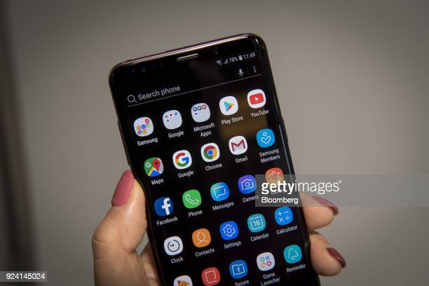 Android app icons sit on the homescreen of the Samsung Electronics Co Galaxy S9 smartphone during the company's media event in San Francisco...