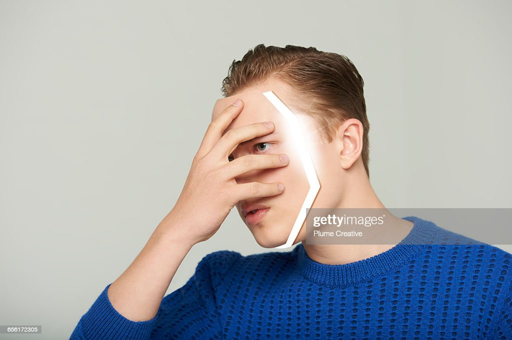 Android man removing his face : Stock Photo