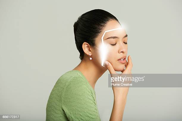 Android woman removing her face