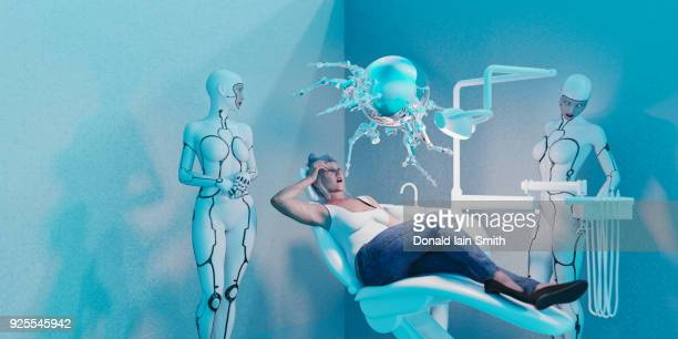 android women watching robot perform dentistry on woman - dental fear stock pictures, royalty-free photos & images