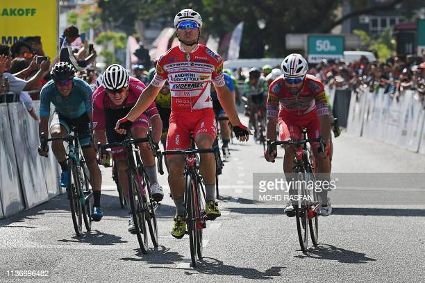 AndroniGiocattoliSidermec's Marco Benfatto of Italy reacts after crossing the finish line to win the eighth and final stage of the Malaysian Le Tour...