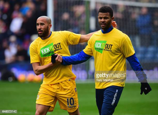 Andros Townsend and Frazier Campbell of Crystal Palace wearing Kick It Out T shirts during the warm up for the Premier League match between West...