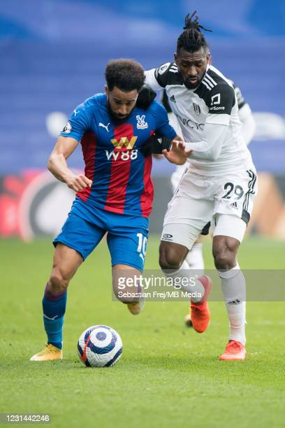 Andros Townsend of Crystal Palace and André-Frank Zambo Anguissa of Fulham in action during the Premier League match between Crystal Palace and...