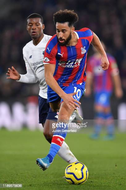 Andros Townsend of Crystal Palace and Georginio Wijnaldum of Liverpool in action during the Premier League match between Crystal Palace and Liverpool...