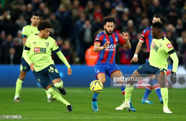 Andros Townsend of Crystal Palace and Jefferson Lerma and Arnaut Danjuma of AFC Bournemouth in action during the Premier League match between Crystal...