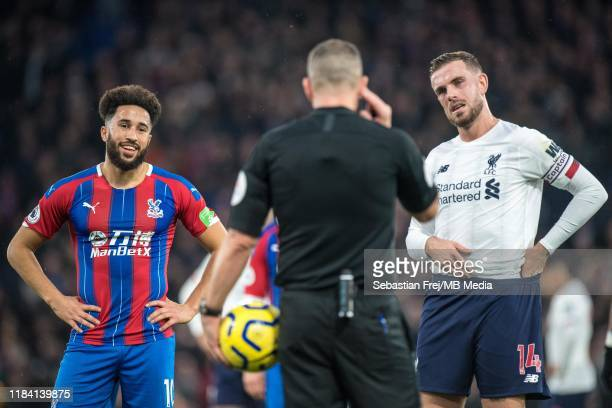 Andros Townsend of Crystal Palace and Jordan Henderson of Liverpool FC awaiting for VAR decision after host score goal during the Premier League...