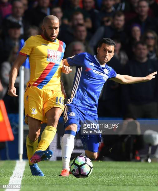 Andros Townsend of Crystal Palace and Pedro of Chelsea battle for possession during the Premier League match between Chelsea and Crystal Palace at...