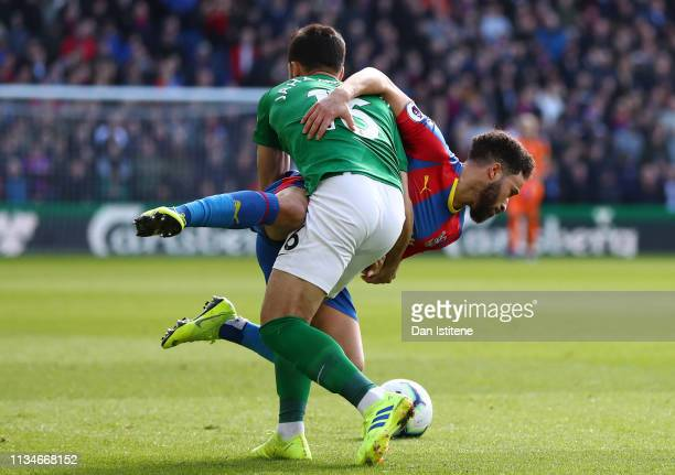 Andros Townsend of Crystal Palace battles for possession with Alireza Jahanbakhsh of Brighton and Hove Albion during the Premier League match between...