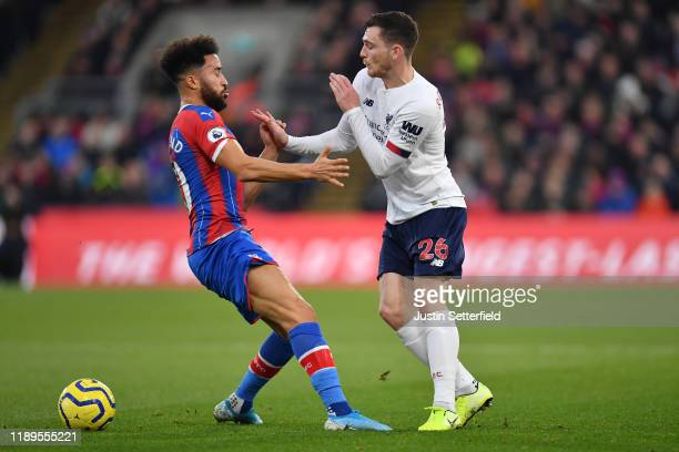 Andros Townsend of Crystal Palace battles for possession with Andy Robertson of Liverpool during the Premier League match between Crystal Palace and...