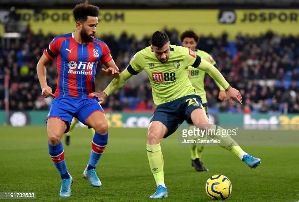 Andros Townsend of Crystal Palace battles for possession with Diego Rico of AFC Bournemouth during the Premier League match between Crystal Palace...