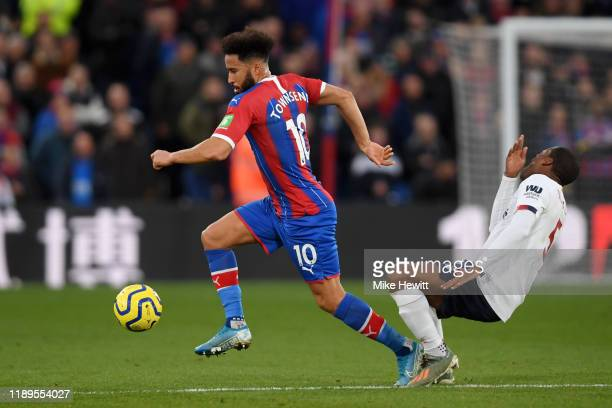 Andros Townsend of Crystal Palace breaks past Georginio Wijnaldum of Liverpool during the Premier League match between Crystal Palace and Liverpool...