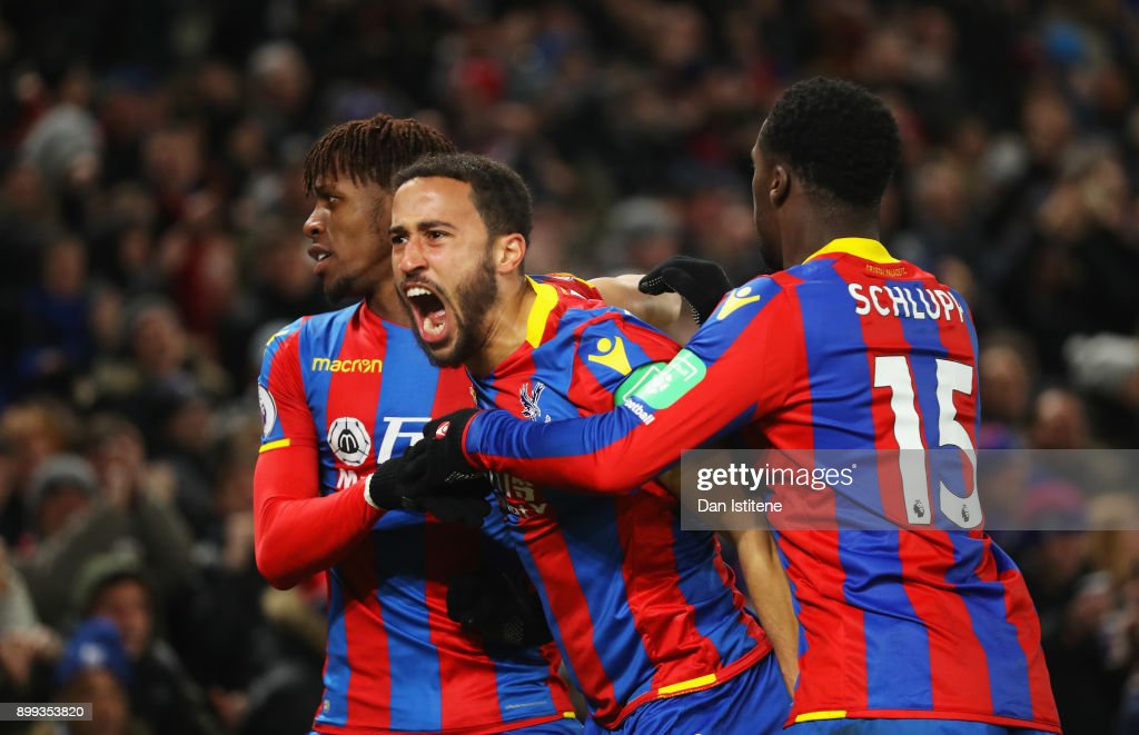 Andros Townsend of Crystal Palace (C) celebrates as he scores their first and equalising goal with team mates Wilfried Zaha and Jeffrey Schlupp during the Premier League match between Crystal Palace and Arsenal at Selhurst Park on December 28, 2017 in London, England.