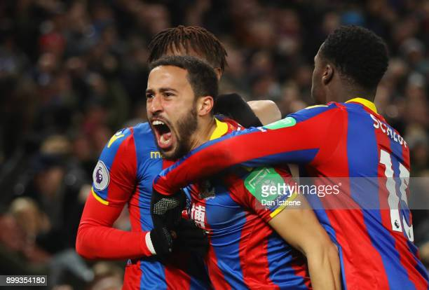 Andros Townsend of Crystal Palace celebrates as he scores their first and equalising goal with team mates Wilfried Zaha and Jeffrey Schlupp during...