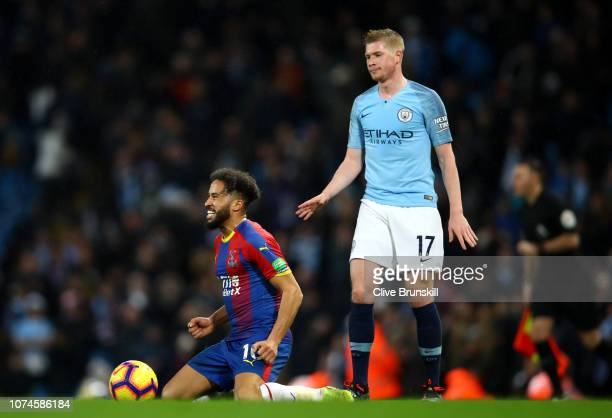 Andros Townsend of Crystal Palace celebrates victory as Kevin De Bruyne of Manchester City looks dejected after the Premier League match between...