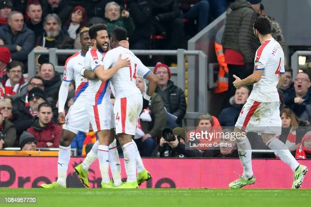 Andros Townsend of Crystal Palace celebrates with teammates after scoring his sides first goal during the Premier League match between Liverpool FC...