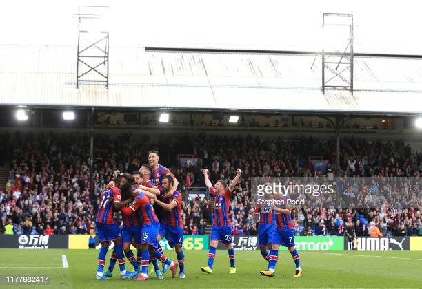 Andros Townsend of Crystal Palace celebrates with teammates after scoring his team's second goal during the Premier League match between Crystal...