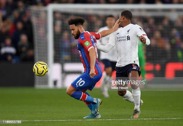 Andros Townsend of Crystal Palace clashes with Georginio Wijnaldum of Liverpool during the Premier League match between Crystal Palace and Liverpool...