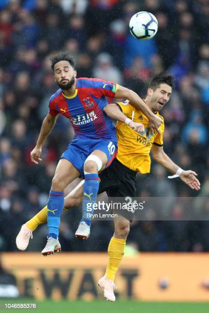 Andros Townsend of Crystal Palace competes for a header with Joao Moutinho of Wolverhampton Wanderers during the Premier League match between Crystal...