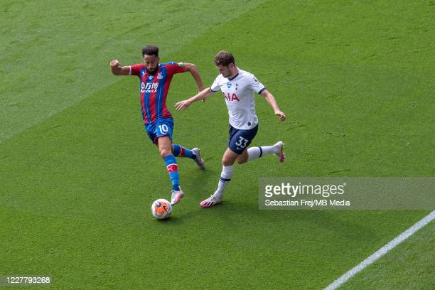 Andros Townsend of Crystal Palace competes for the ball with Ben Davies of Tottenham Hotspur during the Premier League match between Crystal Palace...