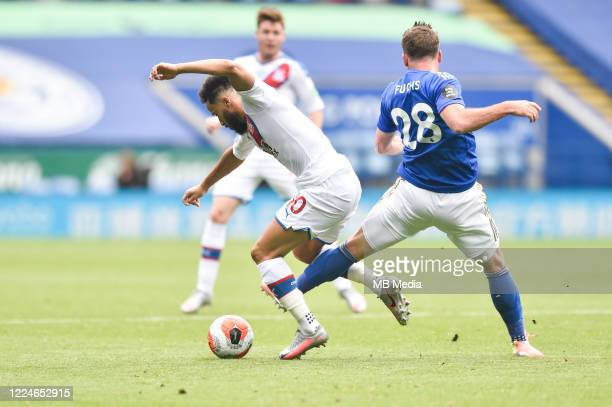 Andros Townsend of Crystal Palace evades a challenge from Christian Fuchs of Leicester City during the Premier League match between Leicester City...