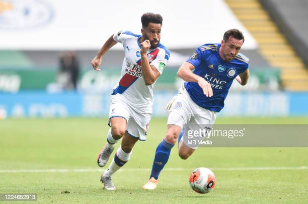 Andros Townsend of Crystal Palace finds a way past Christian Fuchs of Leicester City during the Premier League match between Leicester City and...
