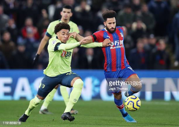 Andros Townsend of Crystal Palace holds off Arnaut Danjuma of AFC Bournemouth during the Premier League match between Crystal Palace and AFC...