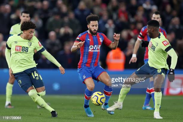 Andros Townsend of Crystal Palace is challenged by Arnaut Danjuma and Jefferson Lerma of AFC Bournemouth during the Premier League match between...