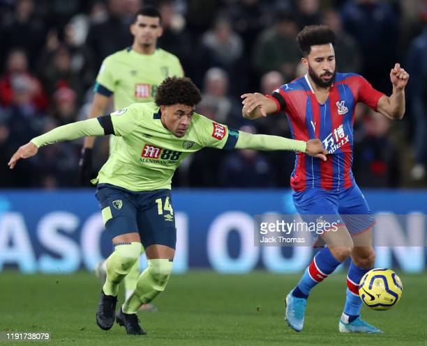 Andros Townsend of Crystal Palace is challenged by Arnaut Danjuma of AFC Bournemouth during the Premier League match between Crystal Palace and AFC...