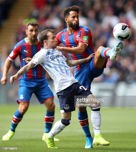 Andros Townsend of Crystal Palace is challenged by Bernard of Everton during the Premier League match between Crystal Palace and Everton FC at...