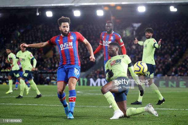 Andros Townsend of Crystal Palace is challenged by Jefferson Lerma of AFC Bournemouth during the Premier League match between Crystal Palace and AFC...